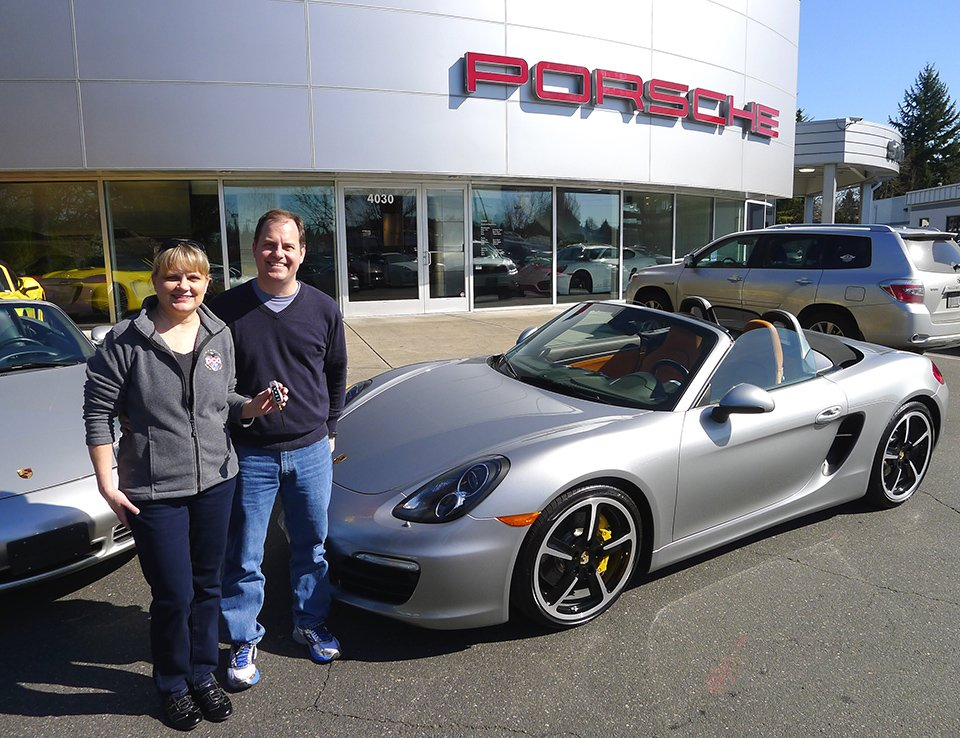 Barb and her husband purchasing their 2013 Porsche 981 Boxster S