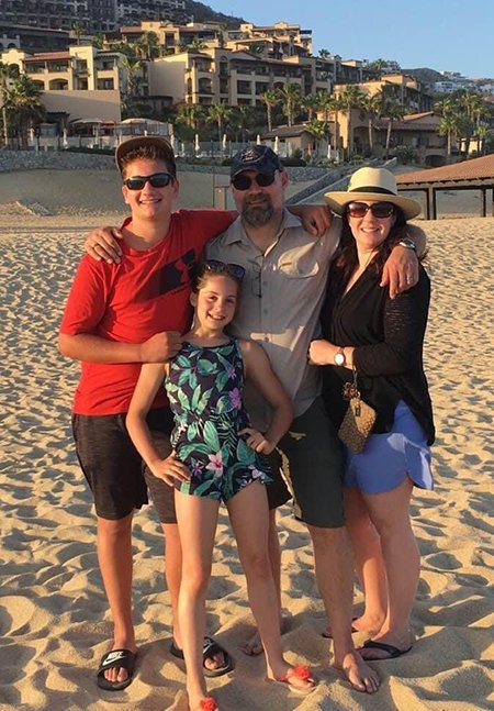 Melissa with her family on vacation in Cabo San Lucas